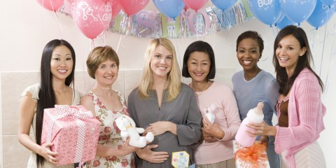 Women Holding Gifts at a Baby Shower