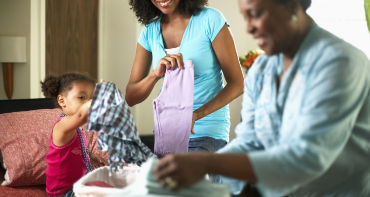 Woman and Little Girl Folding Laundry