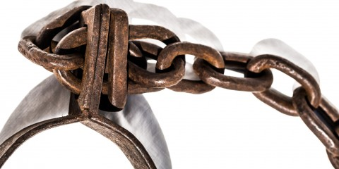 Old chains used for locking up prisoners or slaves