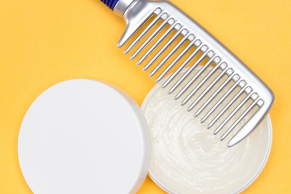 Hair wax with a comb